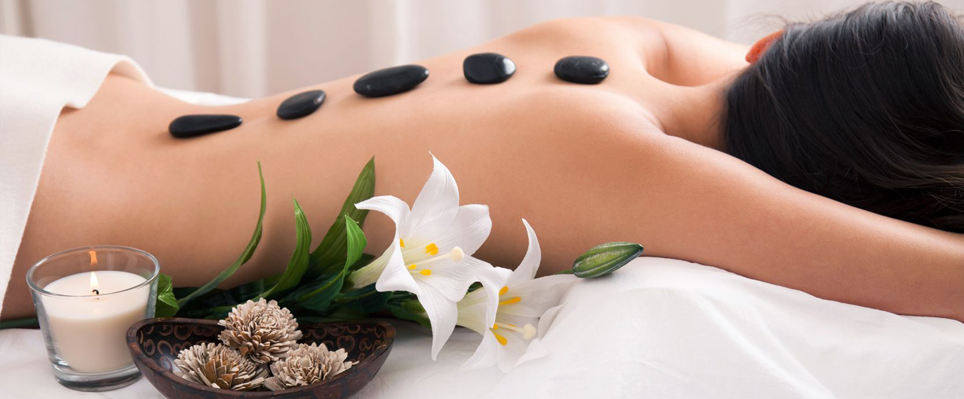 Massage Image with rocks on back at The Spa at Lakeside at Lakeside Event Center